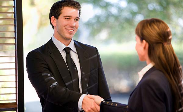 Photo of a Louisville Realtor shaking hands with his client