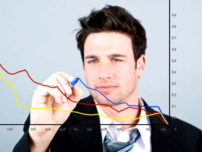 Photo of a man working on a chart