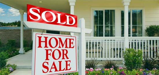 Photo of a home with a SOLD sign in front