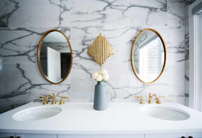 Photo of a bathroom vanity with marble walls