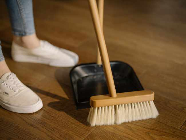 Photo of a woman sweeping