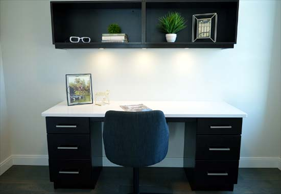 Photo of a home office desk and shelf