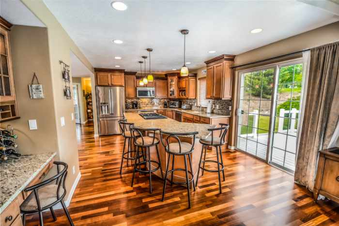 Photo of a kitchen with incredible hardwood floors