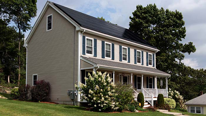 Photo of a home with solar panels on roof