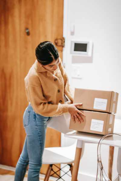 Photo of a woman moving boxes