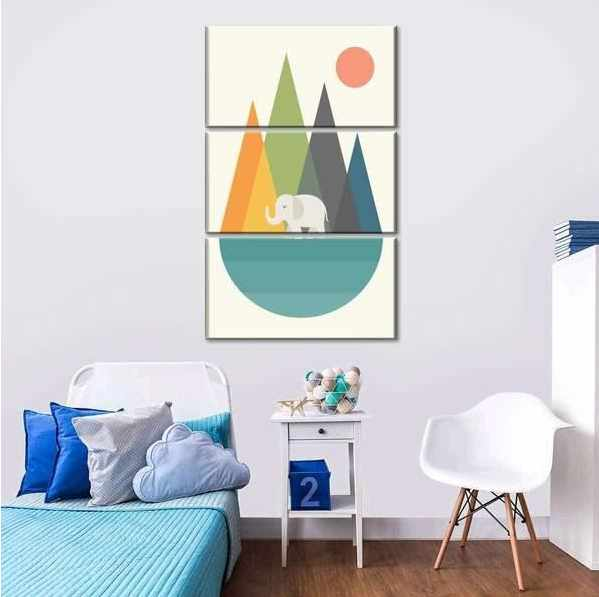 Photo of a kid's room with a triptych picture on the wall
