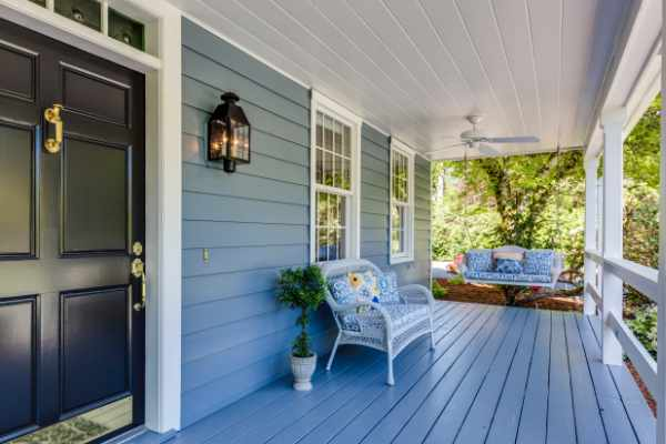 Photo of a front porch that is well staged