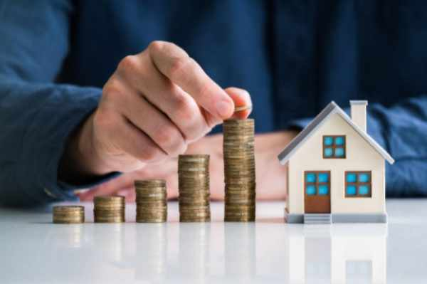 Photo of saving coins to invest in a house